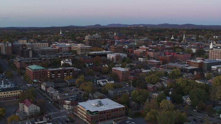 5.7K stock footage aerial video reverse view of downtown office buildings at twilight, Burlington, Vermont Aerial Stock Footage | DX0002_225_025