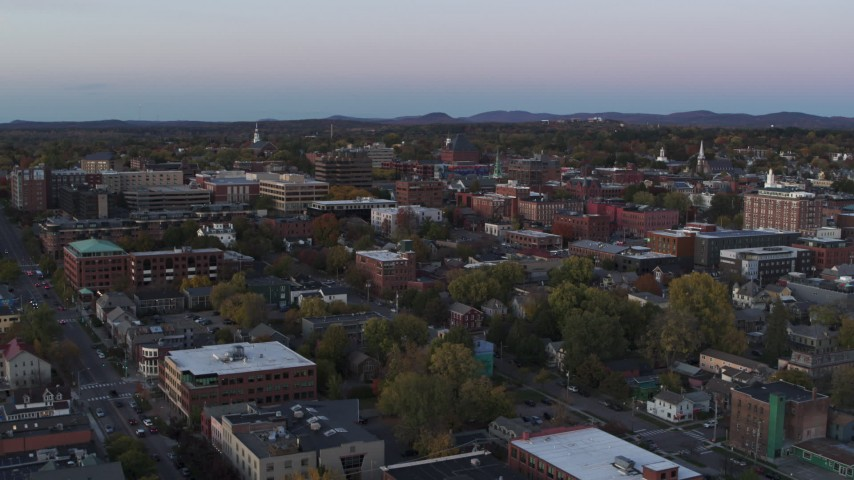 5.7K stock footage aerial video flying over downtown office buildings at twilight, Burlington, Vermont Aerial Stock Footage | DX0002_225_026