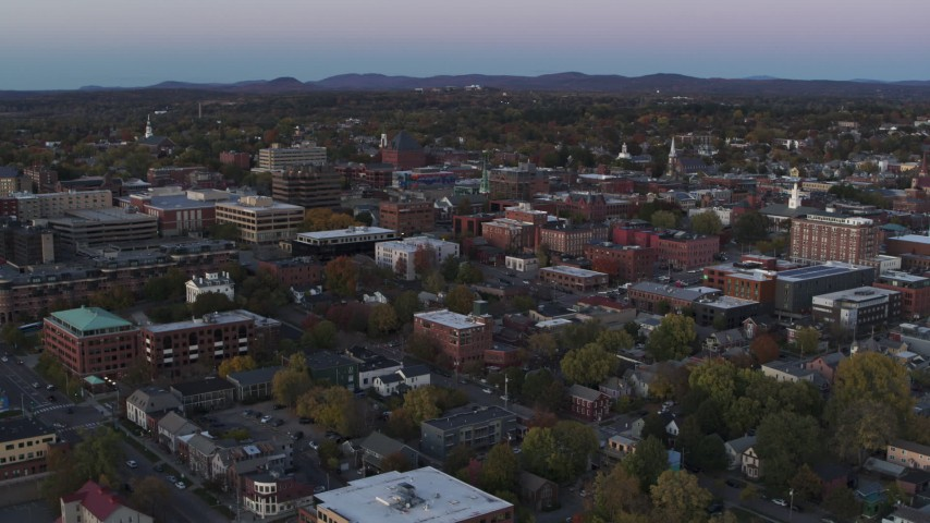 5.7K stock footage aerial video flying away from downtown office buildings at twilight, Burlington, Vermont Aerial Stock Footage | DX0002_225_027