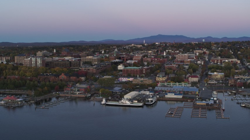 5.7K stock footage aerial video of orbiting downtown buildings and two marinas at twilight, Burlington, Vermont Aerial Stock Footage | DX0002_225_029