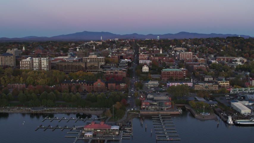 5.7K stock footage aerial video approach and flyby downtown buildings and a marina at twilight, Burlington, Vermont Aerial Stock Footage | DX0002_225_030