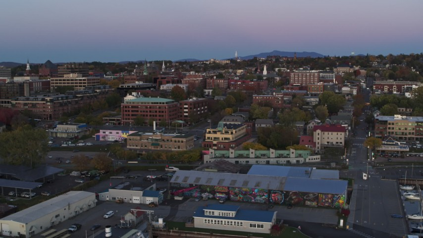 5.7K stock footage aerial video of flying by downtown office buildings at twilight, Burlington, Vermont Aerial Stock Footage | DX0002_225_031