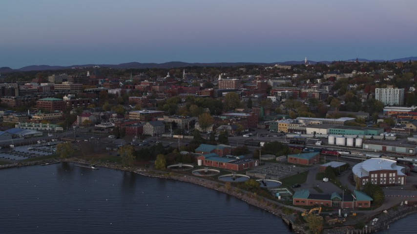 5.7K stock footage aerial video reverse view of downtown buildings at twilight, Burlington, Vermont Aerial Stock Footage | DX0002_225_032