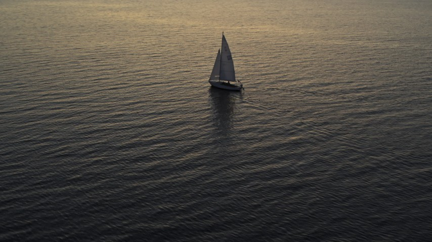 5.7K stock footage aerial video approach and orbit sailboat on Lake Champlain at twilight, Burlington, Vermont Aerial Stock Footage | DX0002_225_034