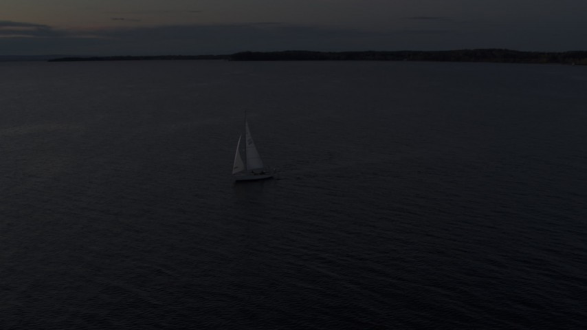 5.7K stock footage aerial video of a sailboat on Lake Champlain at twilight, Burlington, Vermont Aerial Stock Footage | DX0002_225_035
