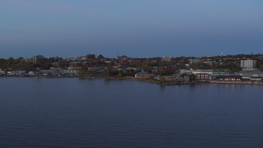 5.7K stock footage aerial video slowly approach downtown buildings from the lake at twilight, Burlington, Vermont Aerial Stock Footage | DX0002_225_037