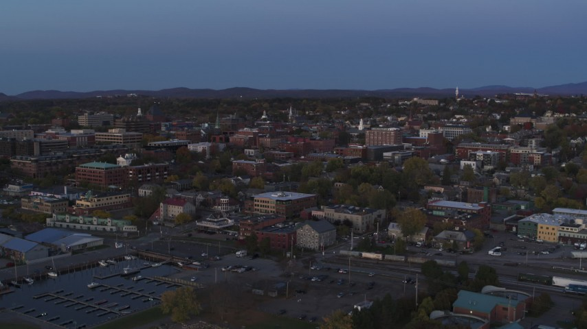 5.7K stock footage aerial video slowly ascending toward downtown buildings from the lake at twilight, Burlington, Vermont Aerial Stock Footage | DX0002_225_038