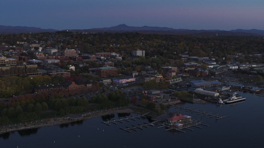 5.7K stock footage aerial video approach and orbit downtown and the lakeside marinas at twilight, Burlington, Vermont Aerial Stock Footage | DX0002_225_042