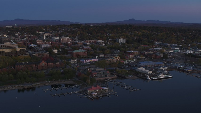 5.7K stock footage aerial video of an orbit around downtown and the lakeside marinas at twilight, Burlington, Vermont Aerial Stock Footage | DX0002_225_043