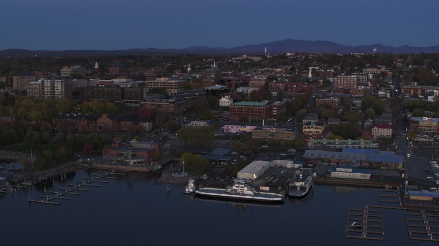 5.7K stock footage aerial video circling around downtown area and the lakeside marinas at twilight, Burlington, Vermont Aerial Stock Footage | DX0002_225_044
