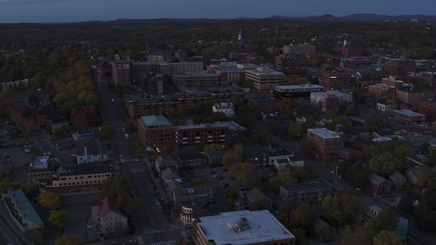 5.7K stock footage aerial video circling and flying away from the downtown area at twilight, Burlington, Vermont Aerial Stock Footage | DX0002_225_046