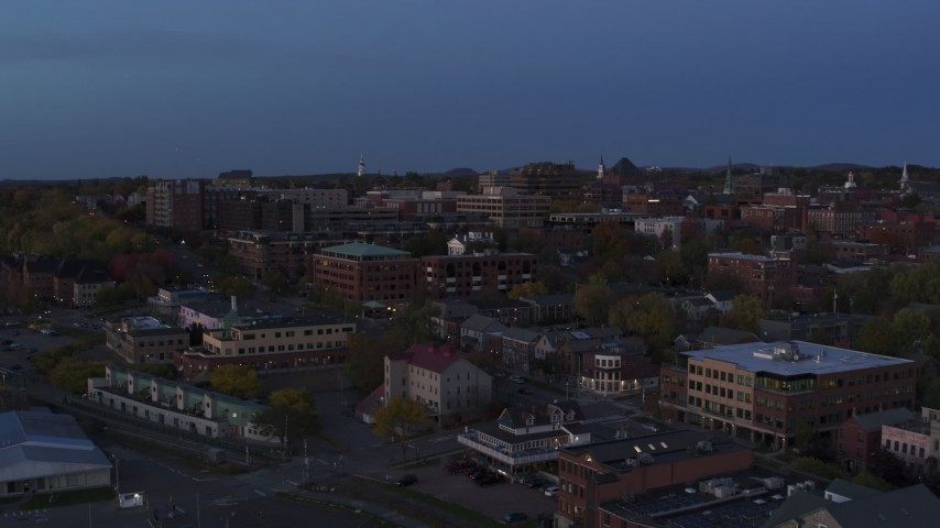 5.7K stock footage aerial video of focusing on downtown area office buildings during descent at twilight, Burlington, Vermont Aerial Stock Footage | DX0002_225_048