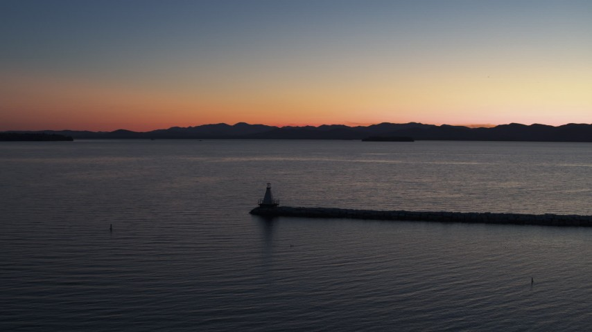5.7K stock footage aerial video stationary view of Lake Champlain lighthouse at twilight, Burlington, Vermont Aerial Stock Footage | DX0002_226_004