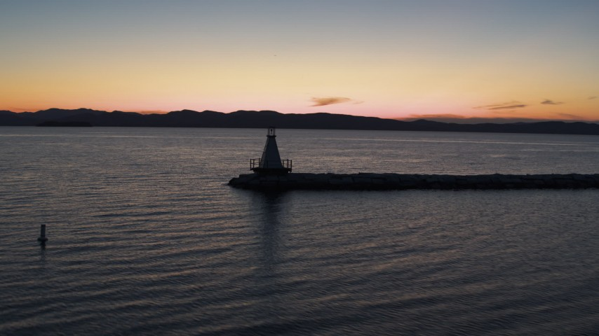 5.7K stock footage aerial video of orbiting a Lake Champlain lighthouse at twilight, Burlington, Vermont Aerial Stock Footage | DX0002_226_005
