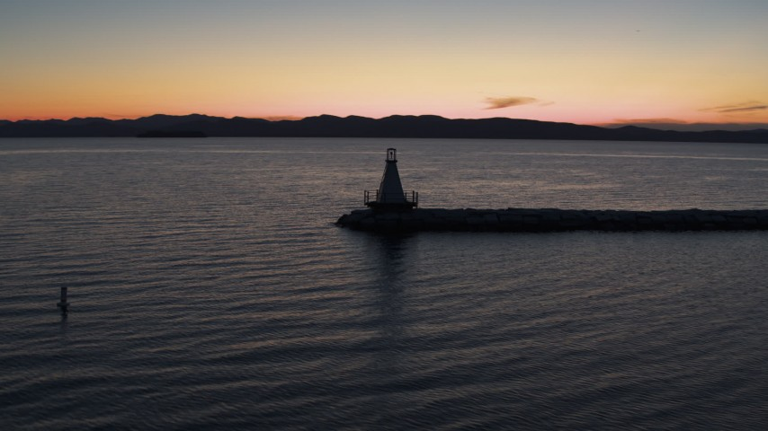 5.7K stock footage aerial video of orbiting around a Lake Champlain lighthouse at twilight, Burlington, Vermont Aerial Stock Footage | DX0002_226_006