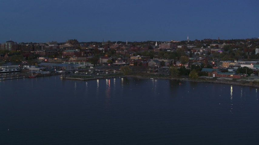5.7K stock footage aerial video fly away from the downtown area at twilight, seen from the lake, Burlington, Vermont Aerial Stock Footage | DX0002_226_008