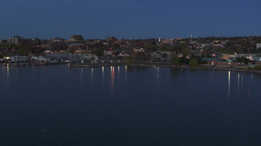 5.7K stock footage aerial video slowly approaching the downtown area at twilight, seen from the lake, Burlington, Vermont Aerial Stock Footage | DX0002_226_009