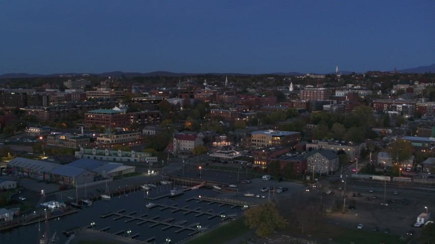 5.7K stock footage aerial video slowly approaching downtown area office buildings at twilight, Burlington, Vermont Aerial Stock Footage | DX0002_226_010
