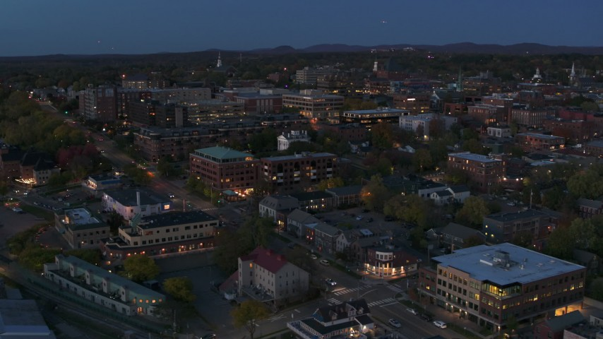 5.7K stock footage aerial video slowly orbit and fly away from downtown area office buildings at twilight, Burlington, Vermont Aerial Stock Footage | DX0002_226_011