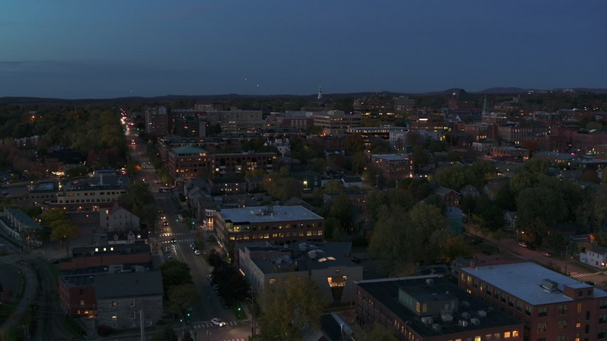 5.7K stock footage aerial video approach and fly over downtown area office buildings at twilight, Burlington, Vermont Aerial Stock Footage | DX0002_226_012