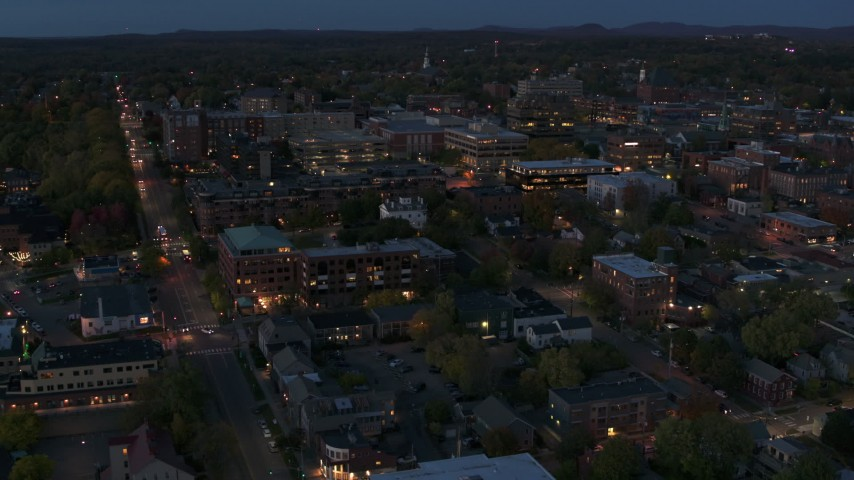 5.7K stock footage aerial video circle and fly away from downtown area office buildings at twilight, Burlington, Vermont Aerial Stock Footage | DX0002_226_013