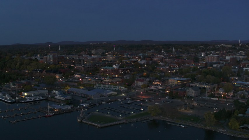 5.7K stock footage aerial video reverse view of city's downtown area at twilight, reveal marina, Burlington, Vermont Aerial Stock Footage | DX0002_226_014
