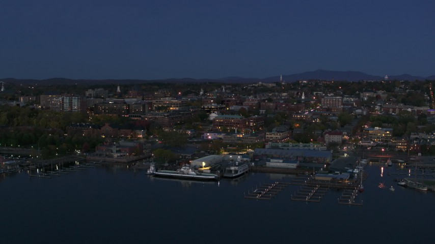 5.7K stock footage aerial video a wide orbit of city's downtown area and marinas at twilight, Burlington, Vermont Aerial Stock Footage | DX0002_226_015