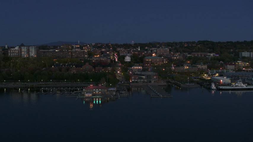 5.7K stock footage aerial video of a slow orbit of city's downtown area and marinas at night, Burlington, Vermont Aerial Stock Footage | DX0002_226_017