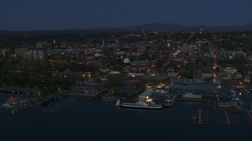 5.7K stock footage aerial video ascend and orbit city's downtown area and marinas at night, Burlington, Vermont Aerial Stock Footage | DX0002_226_018