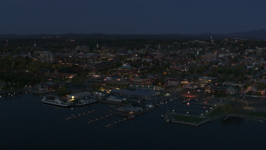 5.7K stock footage aerial video a stationary view of city's downtown area and a marina at night, Burlington, Vermont Aerial Stock Footage | DX0002_226_019