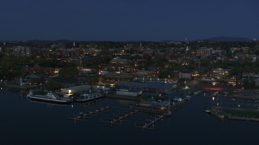 5.7K stock footage aerial video descend past the city's downtown area and a marina at night, Burlington, Vermont Aerial Stock Footage | DX0002_226_020