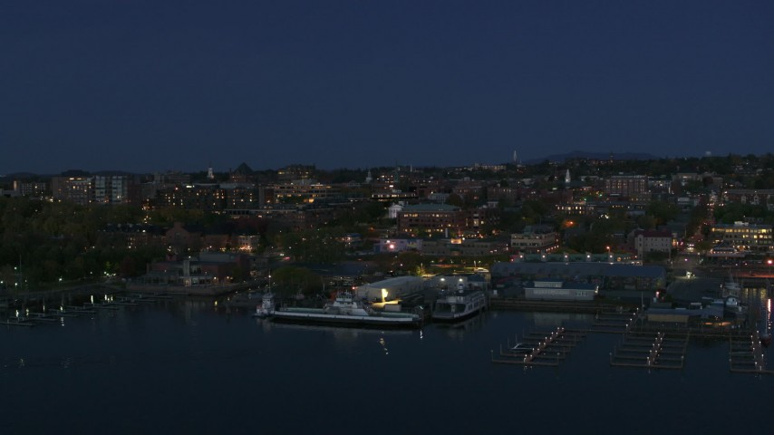 5.7K stock footage aerial video fly away from the city's downtown area and a marina at night, Burlington, Vermont Aerial Stock Footage | DX0002_226_021