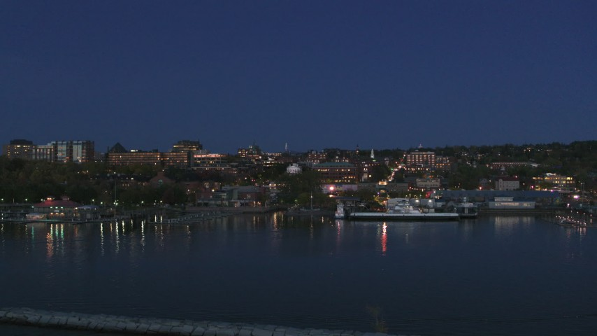 5.7K stock footage aerial video fly low toward the city's downtown area and over a marina at night, Burlington, Vermont Aerial Stock Footage | DX0002_226_022