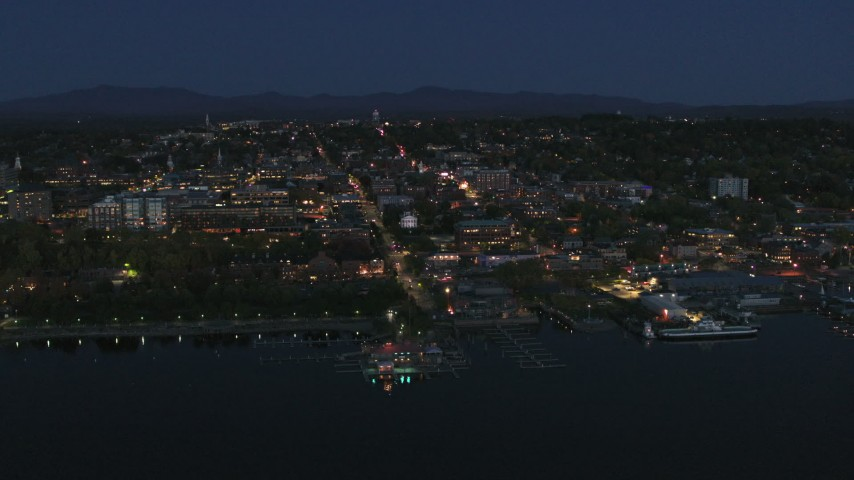 5.7K stock footage aerial video focus on the city's downtown area lit up for the night while orbiting, Burlington, Vermont Aerial Stock Footage | DX0002_226_026