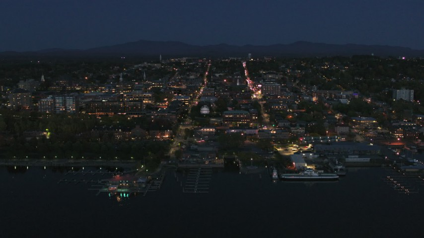 5.7K stock footage aerial video focus on the city's downtown area lit up for the night while approaching, Burlington, Vermont Aerial Stock Footage | DX0002_226_027