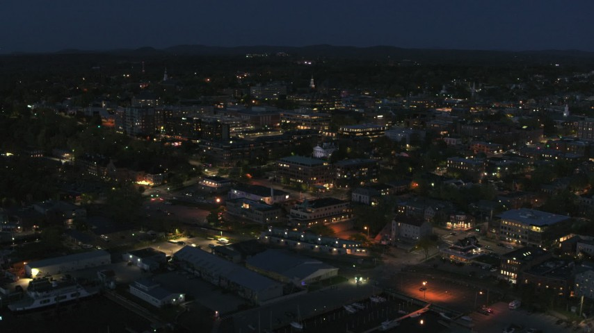 5.7K stock footage aerial video focus on the city's downtown area lit up for the night while circling city, Burlington, Vermont Aerial Stock Footage | DX0002_226_030