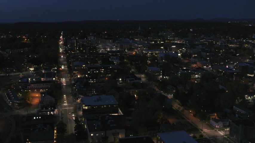 5.7K stock footage aerial video fly away from and orbit the downtown area lit up for nighttime, Burlington, Vermont Aerial Stock Footage | DX0002_226_032