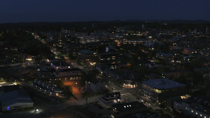 5.7K stock footage aerial video orbit the downtown area lit up for nighttime and descend, Burlington, Vermont Aerial Stock Footage | DX0002_226_033