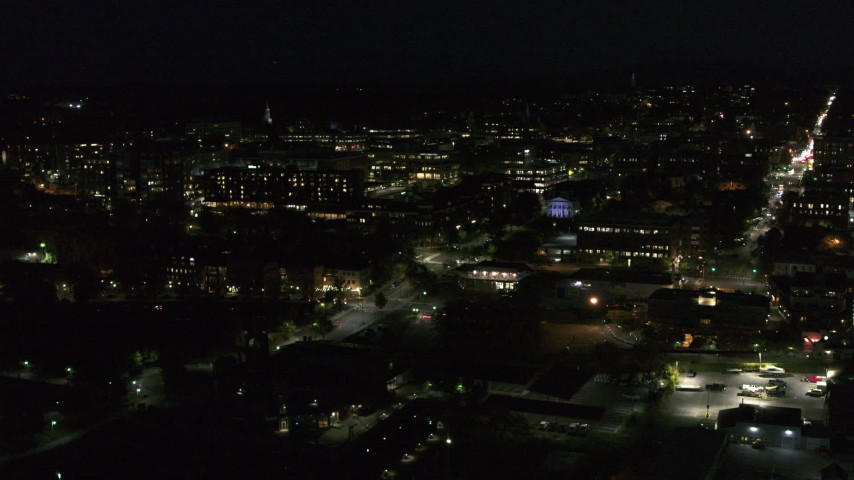 5.7K stock footage aerial video circling the downtown area and College Street lit up for nighttime, Burlington, Vermont Aerial Stock Footage | DX0002_226_034