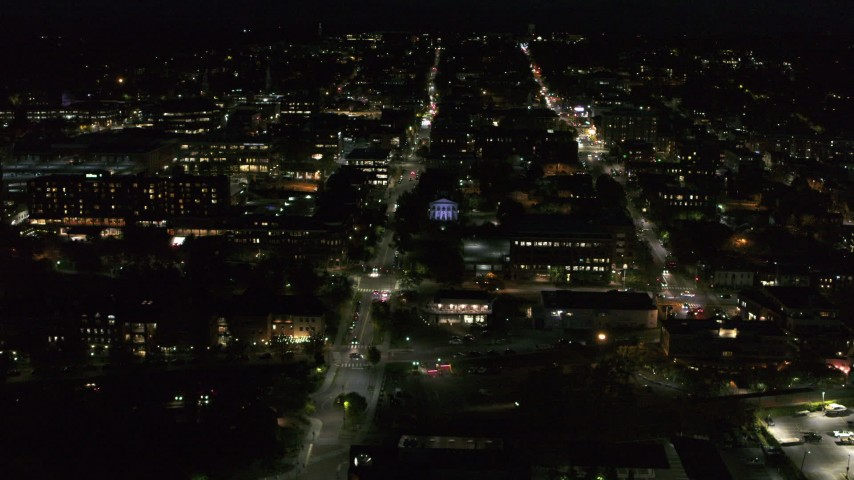 5.7K stock footage aerial video orbit office buildings around College Street lit up for nighttime, Burlington, Vermont Aerial Stock Footage | DX0002_226_036