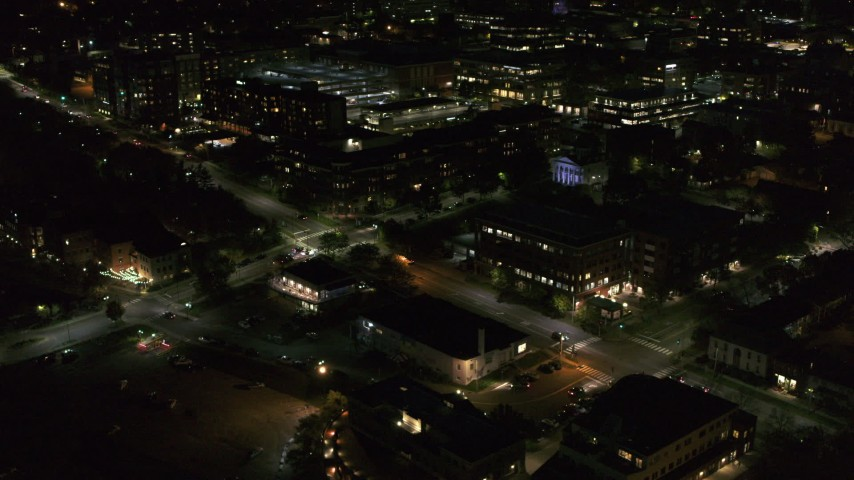 5.7K stock footage aerial video orbit office buildings on Battery Street lit up for nighttime, Burlington, Vermont Aerial Stock Footage | DX0002_226_037