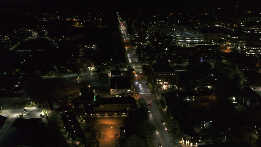 5.7K stock footage aerial video circling and flying away from office buildings on Battery Street lit up for nighttime, Burlington, Vermont Aerial Stock Footage | DX0002_226_038
