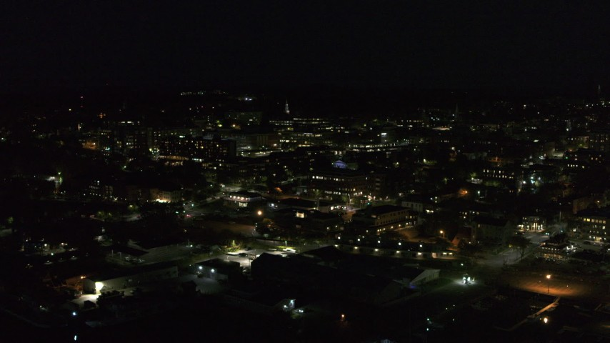 5.7K stock footage aerial video of slowly orbiting office buildings in downtown lit up for nighttime, Burlington, Vermont Aerial Stock Footage | DX0002_226_040