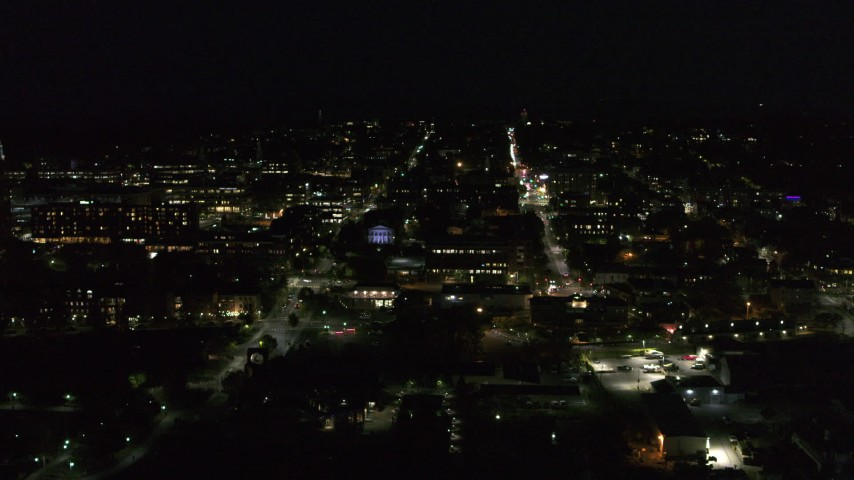 5.7K stock footage aerial video of slowly orbiting office buildings and streets in downtown lit up for nighttime, Burlington, Vermont Aerial Stock Footage | DX0002_226_041