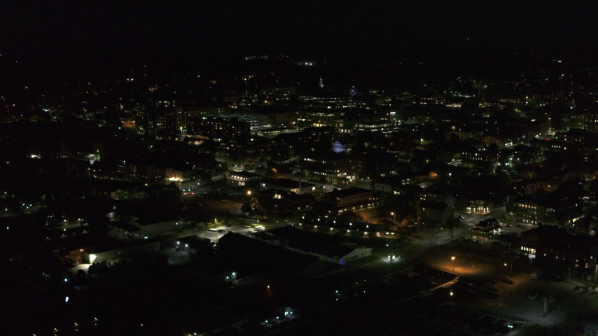5.7K stock footage aerial video of approaching downtown office buildings from the lake at nighttime, Burlington, Vermont Aerial Stock Footage | DX0002_226_046