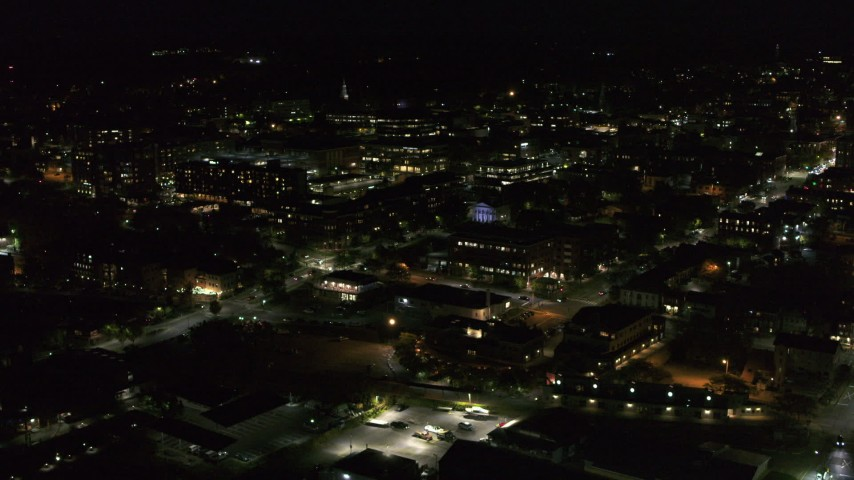5.7K stock footage aerial video of flying around downtown office buildings at nighttime, Burlington, Vermont Aerial Stock Footage | DX0002_226_047