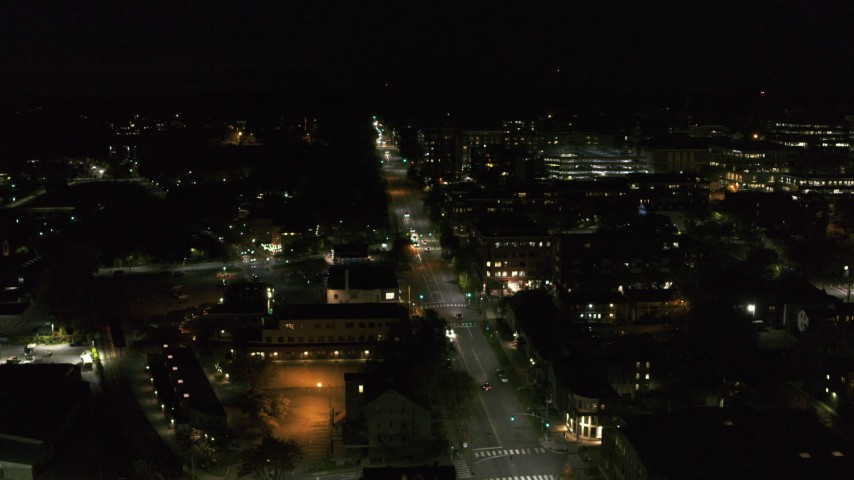 5.7K stock footage aerial video of following Battery Street by office buildings in downtown at night, Burlington, Vermont Aerial Stock Footage | DX0002_226_052