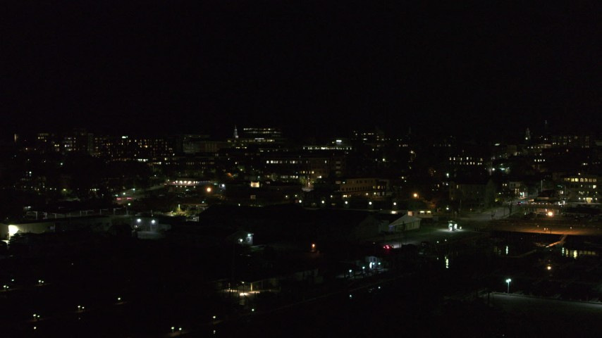 5.7K stock footage aerial video orbit the downtown area at night, seen from marinas, stop for stationary view, Burlington, Vermont Aerial Stock Footage   DX0002_226_060