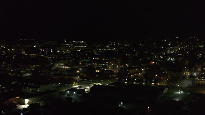 5.7K stock footage aerial video ascend and orbit the downtown area at night, Burlington, Vermont Aerial Stock Footage | DX0002_226_061