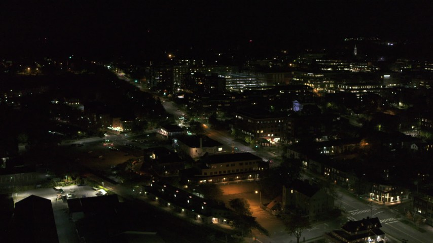 5.7K stock footage aerial video fly away from the downtown area near Battery Street at night and descend, Burlington, Vermont Aerial Stock Footage | DX0002_226_064